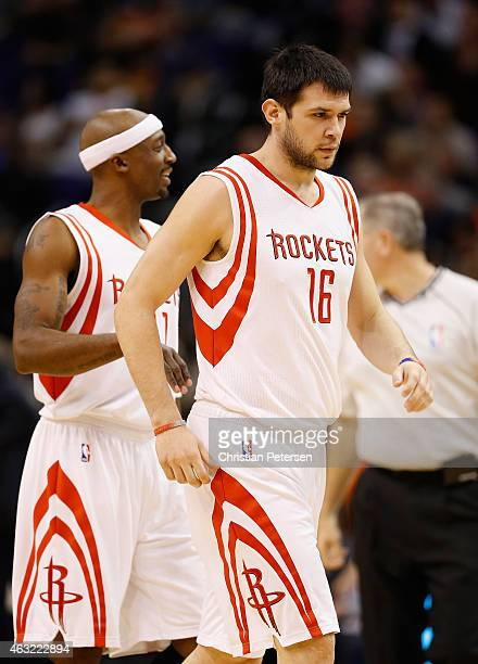 Kostas Papanikolaou of the Houston Rockets reacts with Jason Terry during the NBA game against the Phoenix Suns at US Airways Center on January 23...