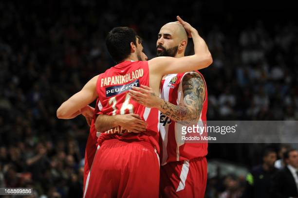 Kostas Papanikolau #16 and Pero Antic #6 of Olympiacos Piraeus celebrates during the Turkish Airlines EuroLeague Final game between Olympiacos...