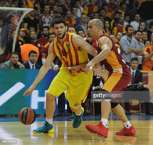 Kostas Papanikolau #16 of FC Barcelona competes with Carlos Arroyo #30 of Galatasaray Liv Hospital Istanbul in action during the Turkish Airlines...