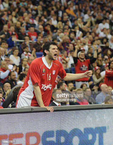 Kostas Papanikolau #16 of Olympiacos Piraeus cheers on his side from the bench during the Turkish Airlines EuroLeague Final game between Olympiacos...