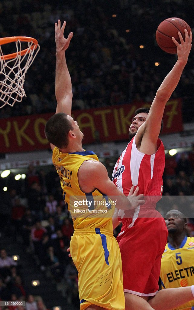 Kostas Papanikolau, #16 of Olympiacos Piraeus in action during the 2012-2013 Turkish Airlines Euroleague Top 16 Date 12 between Olympiacos Piraeus v Maccabi Electra Tel Aviv at Peace and Friendship Stadium on March 22, 2013 in Athens, Greece.