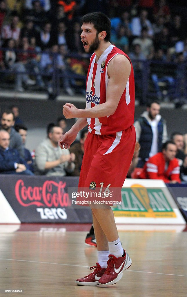 Kostas Papanikolau, #16 of Olympiacos Piraeus reacts during the Turkish Airlines Euroleague 2012-2013 Play Offs game 1 between Olympiacos Piraeus v Anadolu Efes Istanbul at Peace and Friendship Stadium on April 10, 2013 in Athens, Greece.