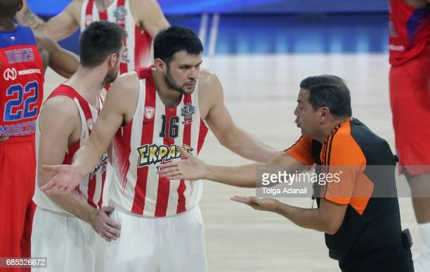 Kostas Papanikolau#16 of Olympiacos Piraeus talks with the referee during the Turkish Airlines EuroLeague Final Four Semifinal B game between CSKA...