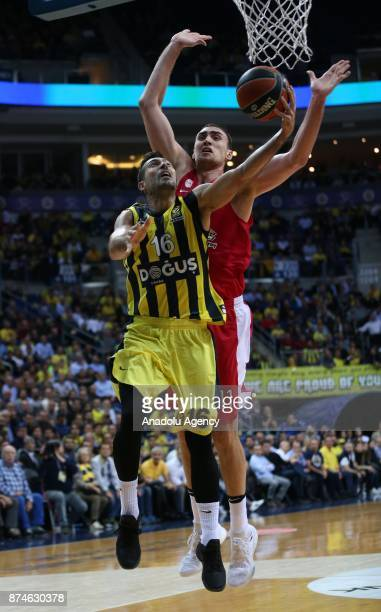 Kostas Sloukas of Fenerbahce Dogus in action against Nikolo Milutinov of Olympiacos during the Turkish Airlines Euroleague basketball match between...