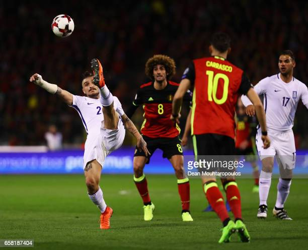 Kostas Stafylidis of Greece clears the ball away from Marouane Fellaini of Belgium during the FIFA 2018 World Cup Group H Qualifier match between...