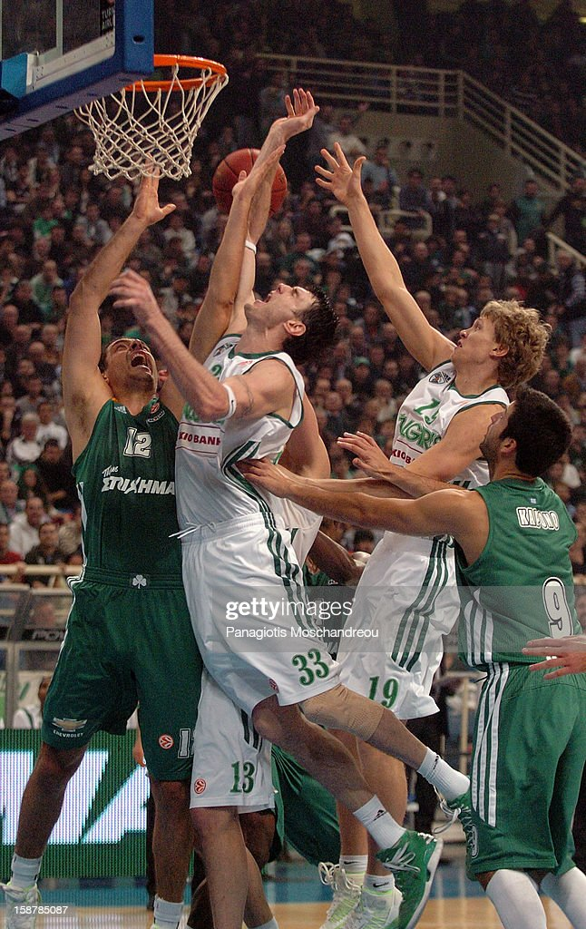 Kostas Tsartsaris, #12 of Panathinaikos Athens competes with Ksistof Lavrinovic, #33 of Zalgiris Kaunas during the 2012-2013 Turkish Airlines Euroleague Top 16 Date 1 between Panathinaikos Athens v Zalgiris Kaunas at OAKA on December 28, 2012 in Athens, Greece.