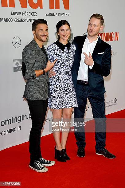Kostja Ullmann Aylin Tezel and Marco Kreuzpaintner attend the 'Coming In' Premiere at Cinemaxx on October 22 2014 in Berlin Germany