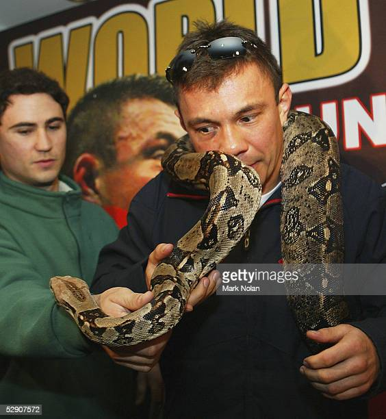 Kostya Tszyu of Australia poses with a Boa Constrictor during the press conference for his up comming fight against Ricky Hatton of Great Britain at...