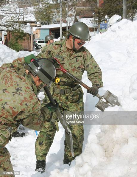 Kosuge Japan Members of the SelfDefense Forces remove snow in the village of Kosuge Yamanashi Prefecture on Feb 19 2014 Paths to the village were...