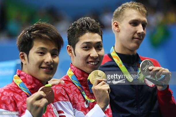 Kosuke Hagino of Japan poses with his medal after winning the final of the Men's 400m IM on Day 1 of the Rio 2016 Olympic Games at the Olympic...