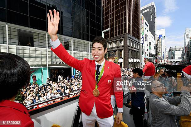 Kosuke Hagino waves during the Rio Olympics 2016 Japanese medalist parade in the ginza district on October 7 2016 in Tokyo Japan