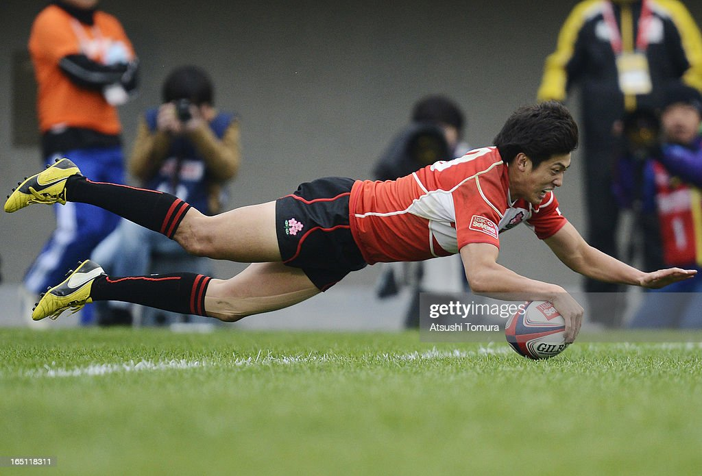 Kosuke Hashino of Japan dives over the line to score a try during the match against Canada on day two of the HSBC Sevens Tokyo at Prince Chichibu Stadium on March 31, 2013 in Tokyo, Japan.