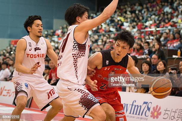 Kosuke Ishii of the Chiba Jets looks to pass during the B League game between Chiba Jets and Toshiba Kawasaki Brave Thunders at Funabashi Arena on...
