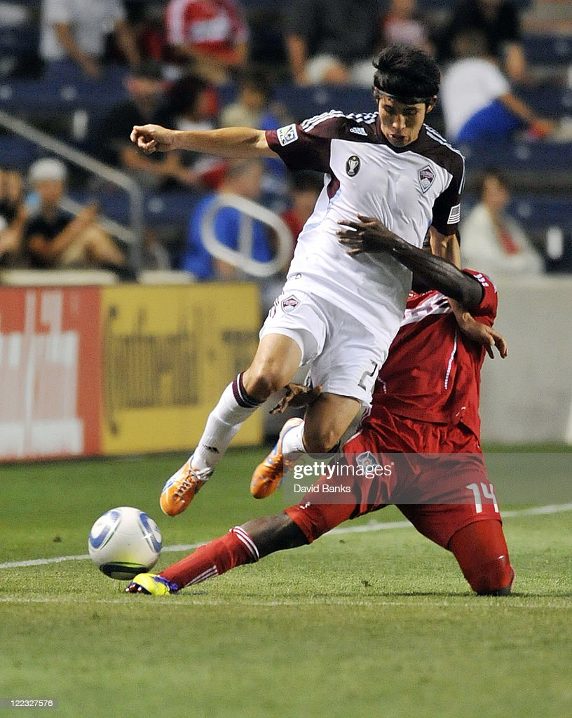 Kosuke Kimura #27 of the Colorado Rapids and Patrick Nyarko #14 of the Chicago Fire go for the ball in an MLS match on August 27, 2011 at Toyota Park in Bridgeview, Illinois. The Fire defeated the Rapids 2-0.