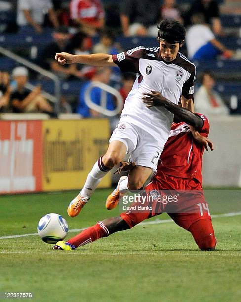 Kosuke Kimura of the Colorado Rapids and Patrick Nyarko of the Chicago Fire go for the ball in an MLS match on August 27 2011 at Toyota Park in...