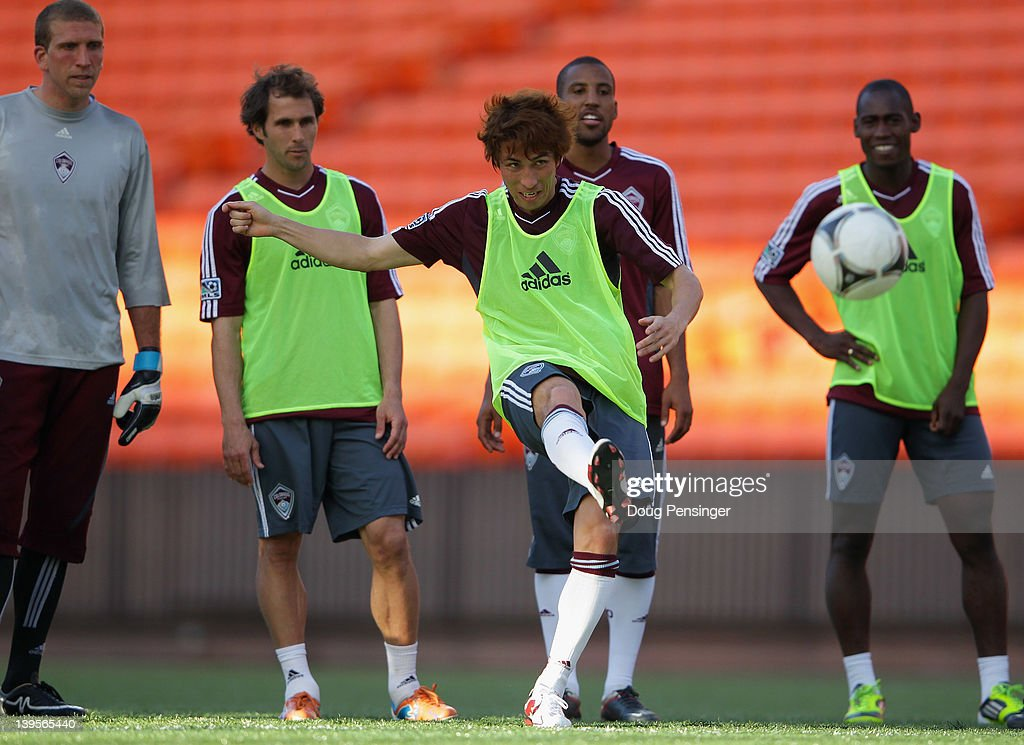 <a gi-track='captionPersonalityLinkClicked' href=/galleries/search?phrase=Kosuke+Kimura&family=editorial&specificpeople=4441829 ng-click='$event.stopPropagation()'>Kosuke Kimura</a> (C) of the Colorado Rapids takes a shot at the goal crossbar as teammates watch during a skills competition at a training session at the Aloha Stadium on February 22, 2012 in Honolulu, Hawaii. The Rapids are preparing for the Hawaiian Islands Invitational Soccer Tournament.