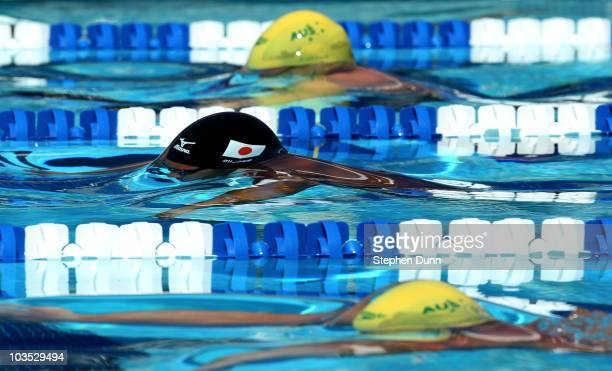 Kosuke Kitajima of Japan comes up off the start between Australians Craig Calder and Brenton Rickard in their men's 200m breaststroke qualifying...