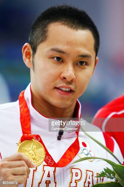 Kosuke Kitajima of Japan poses with the gold medal during the medal ceremony for the Men's 100m Breaststroke held at the National Aquatics Center on...