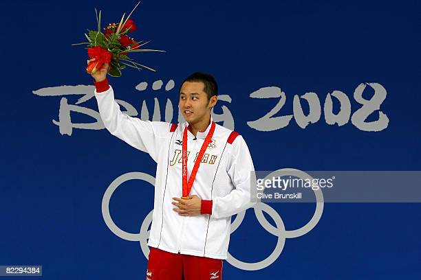 Kosuke Kitajima of Japan poses with the gold medal during the medal ceremony for the Men's 200m Breaststroke held at the National Aquatics Centre...