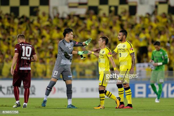 Kosuke Nakamura Ryuta Koike and Ramon Lopes of Kashiwa Reysol celebrate their 31 victory in the JLeague J1 match between Kashiwa Reysol and Vissel...