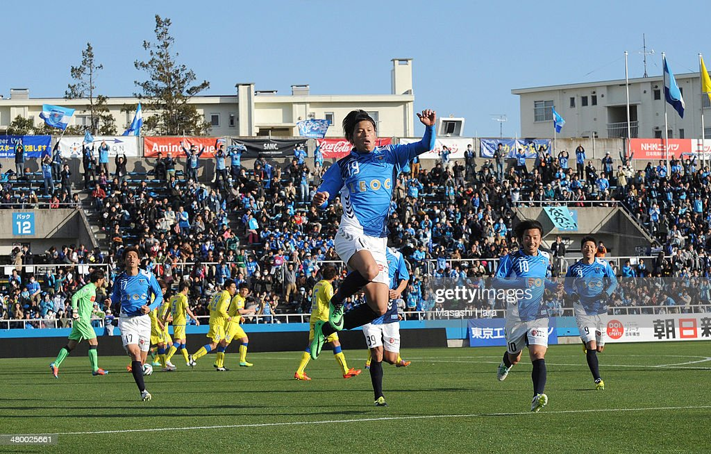 Kosuke Onose #19 of Yokohama FC celebrates the first goal during the J.League second division match between Yokohama F.C. v Montedio Yamagata at Nippatsu Mitsuzawa Stadium on March 22, 2014 in Yokohama, Japan.