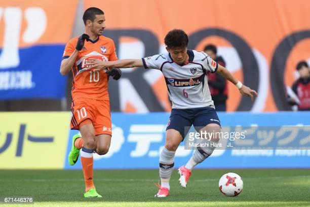 Kosuke Ota of FC Tokyo controls the ball under pressure from Thiago Galhardo of Albirex Niigata during the JLeague J1 match between Albirex Niigata...