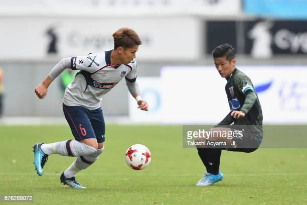 Kosuke Ota of FC Tokyo takes on Akito Fukuta of Sagan Tosu during the JLeague J1 match between Sagan Tosu and FC Tokyo at Best Amenity Stadium on...