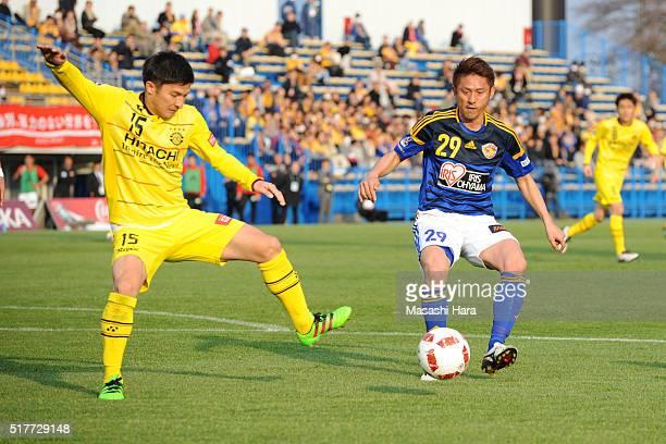 Kosuke Taketomi of Kashiwa Reysol and Koki Mizuno of Vegalta Sendai compete for the ball during the JLeague Yamazaki Nabisco Cup match between...