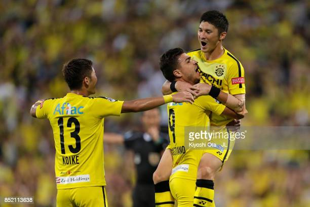 Kosuke Taketomi of Kashiwa Reysol celebrates scoring his side's third goal with his team mates Cristiano and Ryuta Koike during the JLeague J1 match...