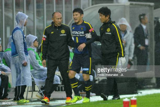 Kosuke Taketomi of Kashiwa Reysol is helped by medical staffs after subsituted during the JLeague J1 match between Omiya Ardija and Kashiwa Reysol at...