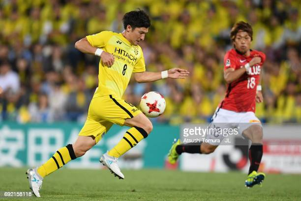 Kosuke Taketomi of Kashiwa Reysol takes on Yoshiaki Komai of Urawa Red Diamonds during the JLeague J1 match between Kashiwa Reysol and Urawa Red...