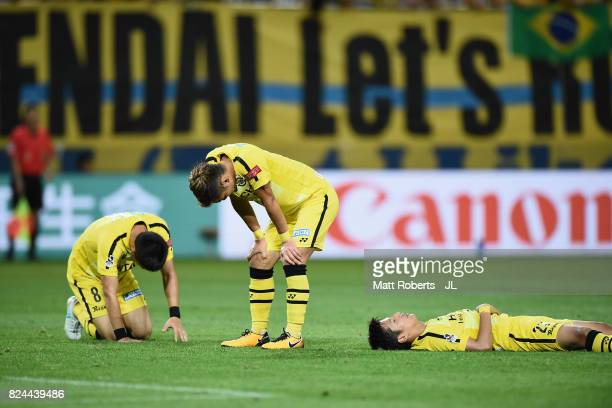 Kosuke Taketomi Ryuta Koike and Naoki Wako of Kashiwa Reysol show dejection after the JLeague J1 match between Vegalta Sendai and Kashiwa Reysol at...