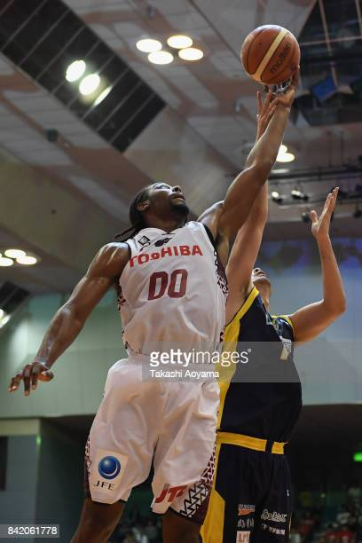 Kosuke Takeuchi of the Tochigi Brex and Josh Davis of the Kawasaki Brave Thunders compete for the ball during the BLeague Kanto Early Cup 3rd place...