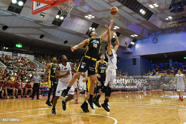 Kosuke Takeuchi of the Tochigi Brex contests a rebound with Takahiro Kurihara of the Kawasaki Brave Thunders during the BLeague Kanto Early Cup 3rd...