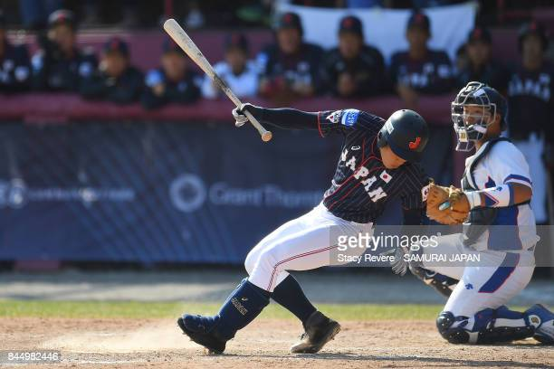 Kosuteke Ito of Japan avoids a wild pitch during the ninth inning of a game against Korea during the WBSC U18 Baseball World Cup Super Round game...