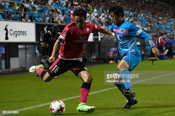 Kota Mizunuma of Cerezo Osaka and Yoshiki Takahashi of Sagan Tosu compete for the ball during the JLeague J1 match between Sagan Tosu and Cerezo...