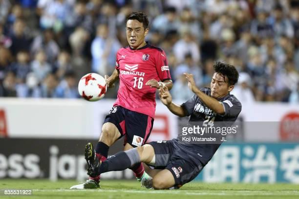 Kota Mizunuma of Cerezo Osaka is tackled by Daiki Ogawa of Jubilo Iwata during the JLeague J1 match between Jubilo Iwata and Cerezo Osaka at Yamaha...
