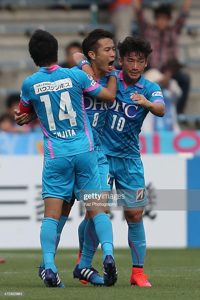 Kota Mizunuma (C) of Sagan Tosu celebrates scoring his team's second goal with his team mates Naoyuki Fujita (L) and Kim Min-Woo (R) during the J.League match between Shimizu S-Pulse and Sagan Tosu at IAI Stadium Nihondaira on May 6, 2015 in Shizuoka, Japan.