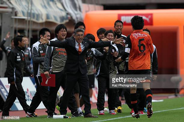 Kota Sugiyama of Shimizu SPulse is congratulated by head coach Afshin Ghotbi after scoring his team's third goal during the JLeague match between...