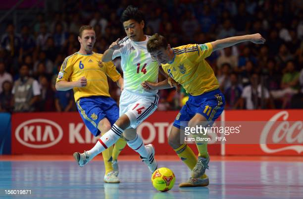 Kotaro Inaba of Japan is challenged by Denys Ovsiannikov of Ukraine during the FIFA Futsal World Cup Round of 16 match between Ukraine and Japan at...