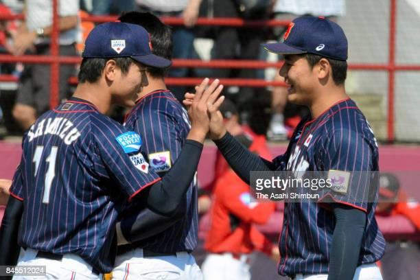 Kotaro Kiyomiya and Tatsuya Shimizu of Japan high five after the WBSC U18 Baseball World Cup Bronze Medal Game between Japan and Canada at Port...