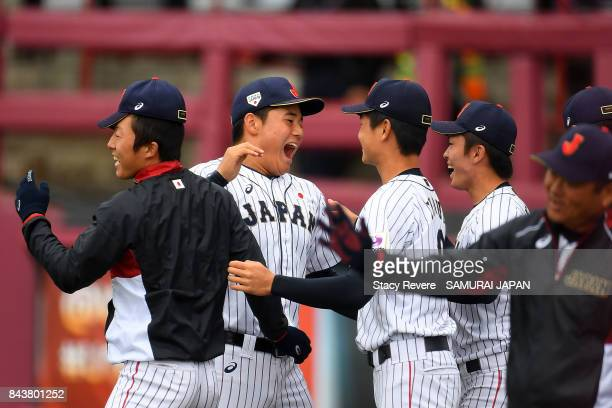 Kotaro Kiyomiya of Japan celebrates with teammates during the tenth inning of a game against Australia during the WBSC U18 Baseball World Cup Super...