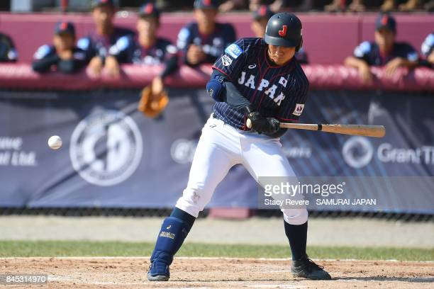 Kotaro Kiyomiya of Japan gets a base hit RBI during the third inning of a game against Canada during the WBSC U18 Baseball World Cup Bronze Medal...