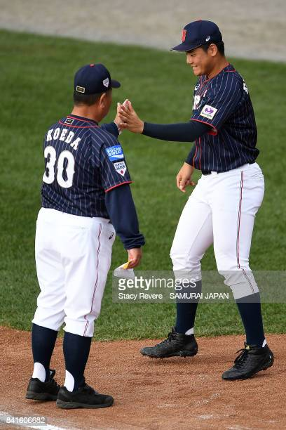 Kotaro Kiyomiya of Japan greets manager Mamoru Koeda prior to the WBSC U18 Baseball World Cup Group B game between Japan and Mexico at Port Arthur...