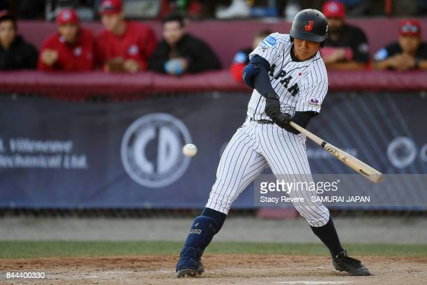 Kotaro Kiyomiya of Japan hits a solo home run during the fifth inning of a game against Canada during the WBSC U18 Baseball World Cup Super Round...