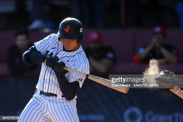 Kotaro Kiyomiya of Japan is called out on strikes during the first inning of a game against Canada during the WBSC U18 Baseball World Cup Super Round...