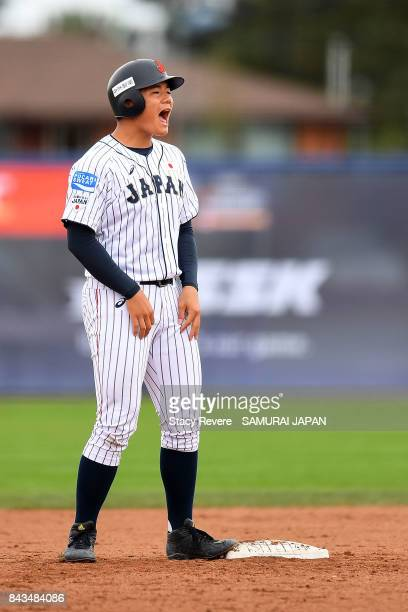 Kotaro Kiyomiya of Japan reacts to a play against South Africa during the WBSC U18 Baseball World Cup Group B game between South Africa and Japan at...