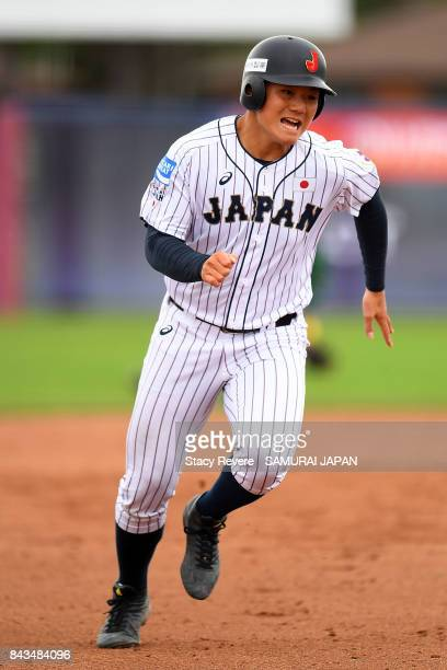 Kotaro Kiyomiya of Japan scores from second base during the sixth inning of a game against South Africa during the WBSC U18 Baseball World Cup Group...