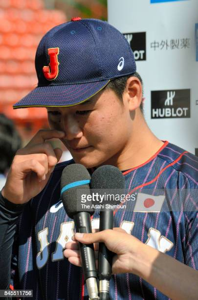 Kotaro Kiyomiya of Japan speaks to media reporters after the WBSC U18 Baseball World Cup Bronze Medal Game between Japan and Canada at Port Arthur...