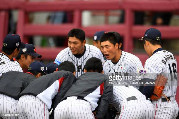 Kotaro Kiyomiya of Japan speaks with teammates during the tenth inning of a game against Australia during the WBSC U18 Baseball World Cup Super Round...